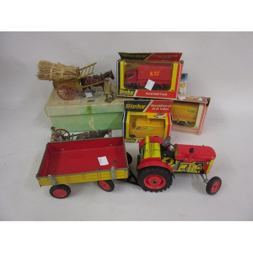 152 - Mid 20th Century tin plate clockwork toy tractor with trailer, a Britains Home Farm Series tumbril i...