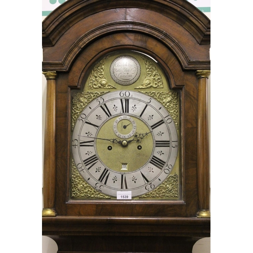 1539 - Figured walnut longcase clock, the broken arch hood with flanking pilasters above a moulded panel do...