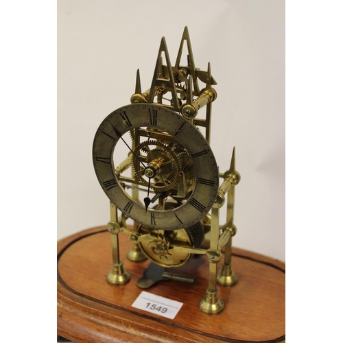 1549 - Small 19th Century brass skeleton clock, the silvered dial with Roman numerals and single train fuse...