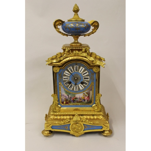 1553 - 19th Century French ormolu mantel clock having porcelain mounts, the dial with Roman numerals and sc...