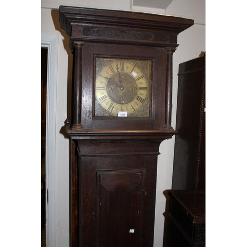 1554 - Oak longcase clock, the square hood above a rectangular panelled door, the 10in brass dial signed Ri...