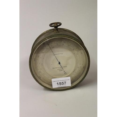 1557 - Circular brass cased compensated barometer by Negretti and Zambra, London, No. 12206, 4.75ins diamet...