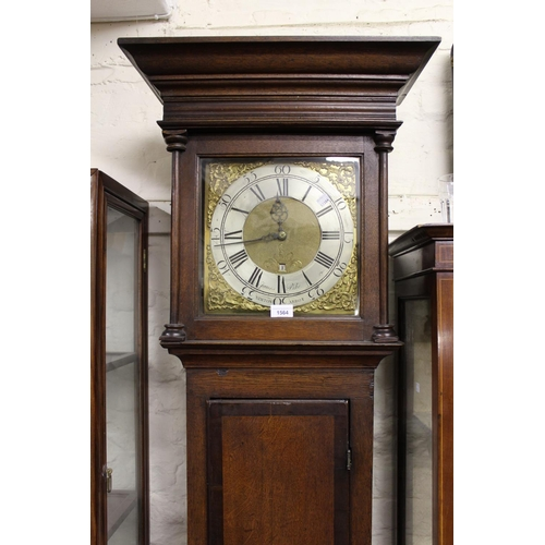 1564 - 18th Century oak longcase clock, the square hood above a panel door and conforming plinth base, the ...