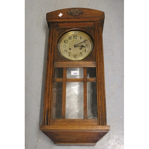 1568 - 20th Century oak cased Vienna style wall clock having circular silvered dial with Arabic numerals an...