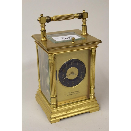 1575 - Late 19th Century gilt brass cased carriage clock, the Royal blue enamel dial with Arabic numerals o...