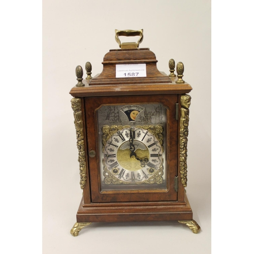 1587 - Small reproduction walnut cased two train mantel clock with moonphase dial, together with a French b...