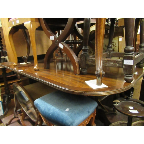 1599 - Reproduction mahogany rectangular dining table and a set of four Regency style rope back dining chai...