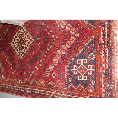 16 - Shiraz rug of centre medallion and all-over geometric floral design with borders, approximately 9ft ...