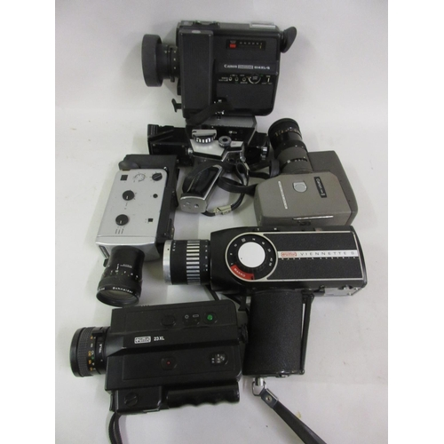 160 - Box containing a group of various cine cameras including Canon...