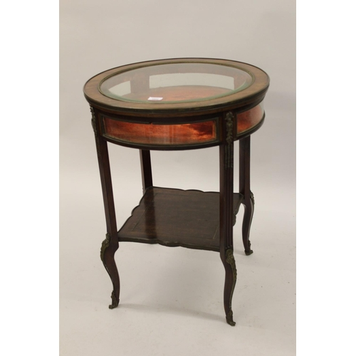 1602 - Late 19th Century French circular mahogany ormolu mounted bijouterie cabinet, the hinged bevelled gl...