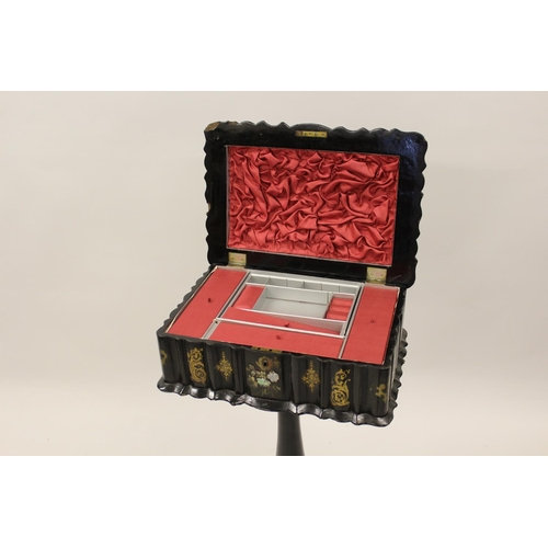 1603 - Victorian black lacquered papier mache, mother of pearl inlaid and gilt decorated work box, the hing...
