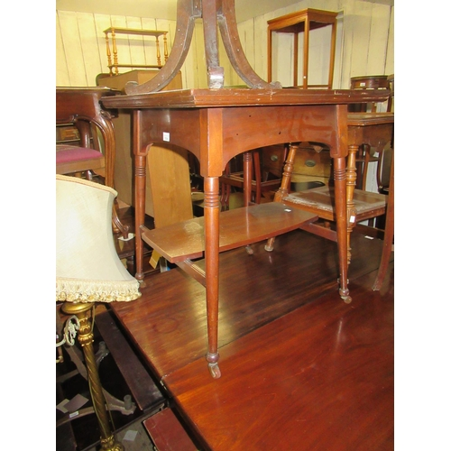 1604 - Arts and Crafts square walnut two tier occasional table on turned supports...