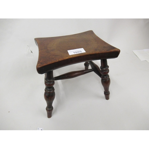 1605 - Small George III mahogany stool with a shaped top, raised on four turned tapering supports with H-st...