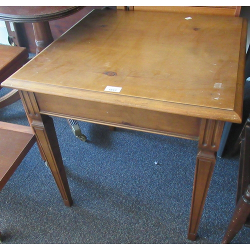 1612 - 20th Century square pine lamp table on square tapering supports...