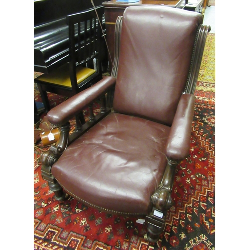 1630A - Victorian burgundy leather upholstered library armchair on turned tapering front supports...