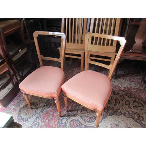 1631 - Pair of Victorian figured walnut and line inlaid side chairs on turned tapering front supports, toge...