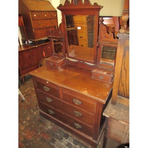1633 - Late Victorian walnut dressing chest, with swing mirror above drawers on a plinth base...