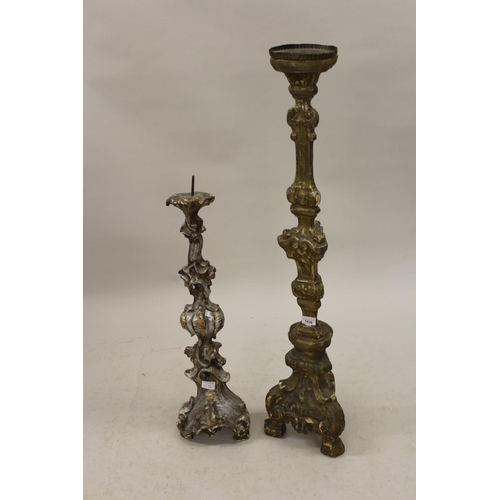 1636 - Two antique Italian carved silvered and gilded wood candle stands (with repairs), 41ins high and 28i...