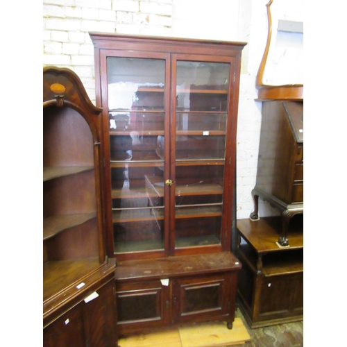 1641 - Mahogany, rosewood and pine two door bookcase, together with an Edwardian mahogany and inlaid dressi...