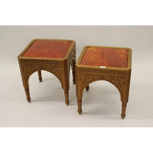 1644 - Pair of late 19th Century Aesthetic Movement carved pine stools, the square leather inset tops above...