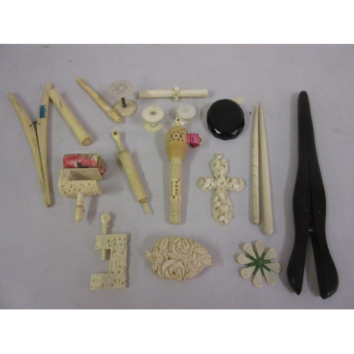165 - 19th Century carved ivory sewing clamp, a bodkin with Stanhope viewer in the form of an umbrella, a ...