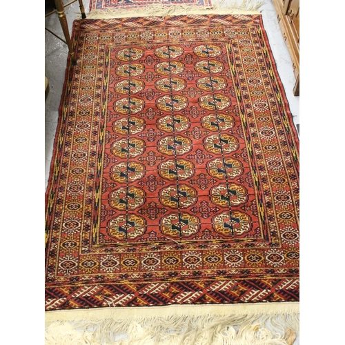 17 - Bokhara rug decorated with three rows of nine gols on wine ground, approximately 60ins x 36ins...