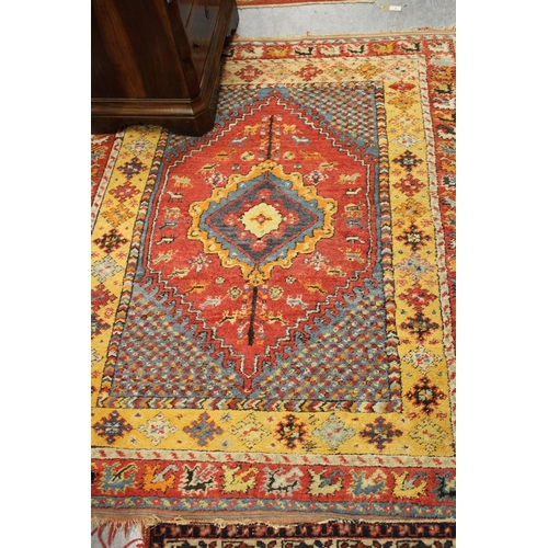 18 - Small Turkish rug with a medallion design in shades of pale blue, pink and orange...