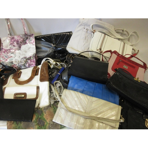 19 - Quantity of various ladies handbags, together with a quantity of ladies belts...