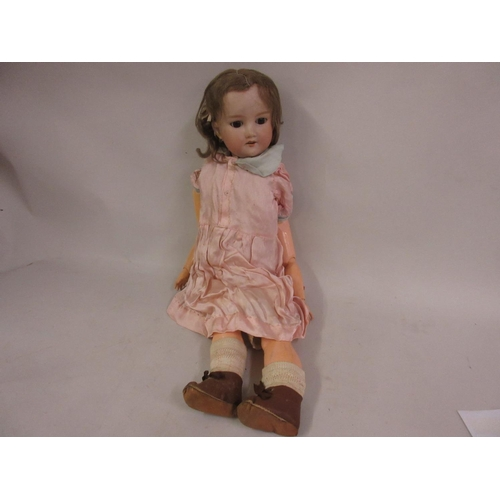 198 - Armand Marseille bisque headed doll marked 390 A6M with a jointed composition body...