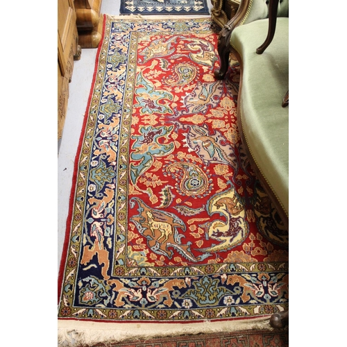 2 - Indo Persian rug with stylised all-over design on red ground with borders, approximately 7ft x 4ft 6...