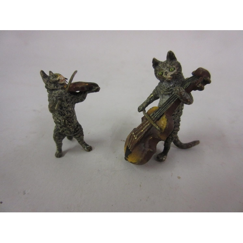 202 - Two small Viennese cold painted bronze figures of cats playing musical instruments, 1.25ins high...