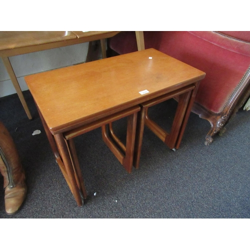 2069 - Mid 20th Century McIntosh teak nest of three tables with fold-over top...