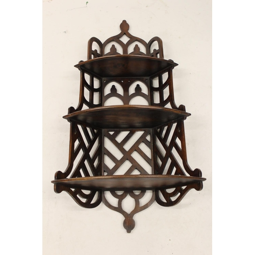 2070 - Mahogany three shelf Gothic style corner wall bracket...