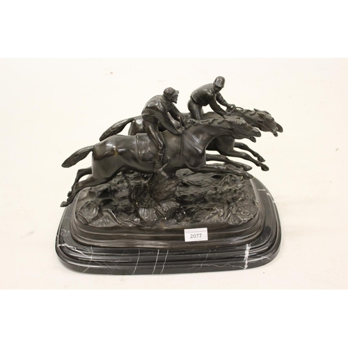 2077 - 20th Century brown patinated bronze group of two racehorses with jockeys, mounted on a rectangular b...