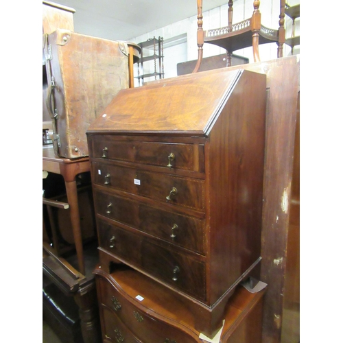 2084 - Early 20th Century mahogany bureau with a fall front above graduated drawers...