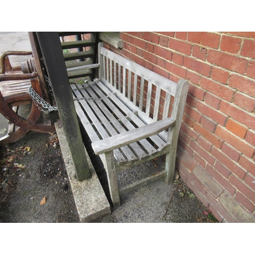 2089 - Weathered teak garden bench with slatted back and seat...