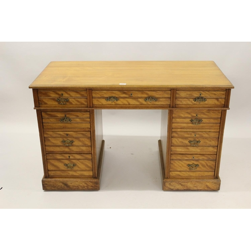 2090 - Late 19th Century satin birch twin pedestal desk, the moulded top above nine drawers, stamped Shoolb...