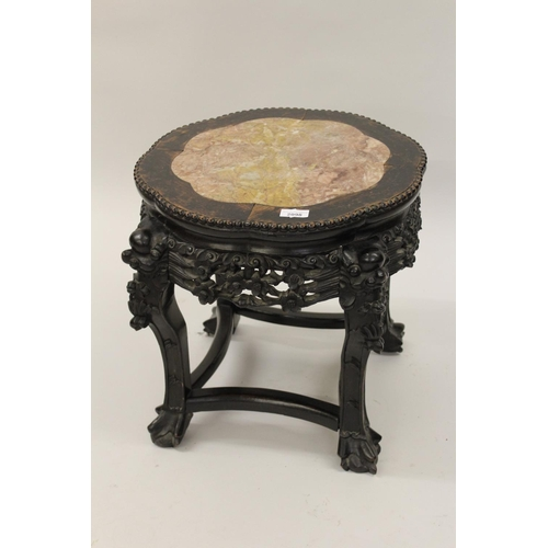 2098 - 19th Century Chinese carved hardwood vase stand with a marble inset top...