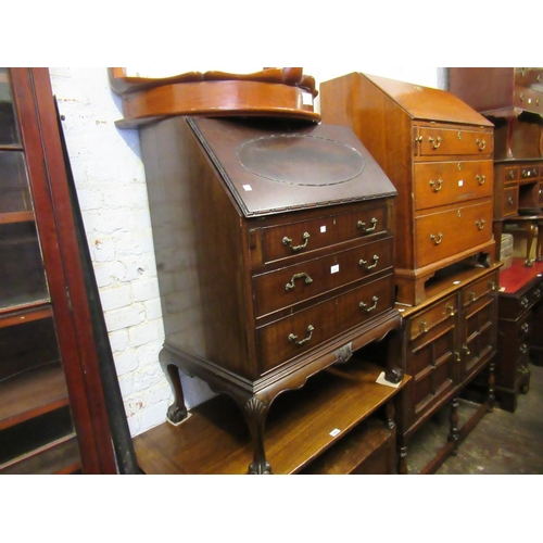 2101 - Mahogany bureau with fall front above three drawers on shell carved cabriole claw and ball supports...
