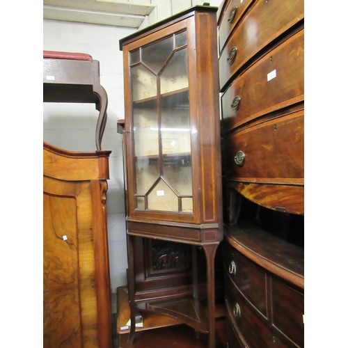 2117 - Small Edwardian mahogany and line inlaid standing corner cabinet with a bar glazed door enclosing sh...
