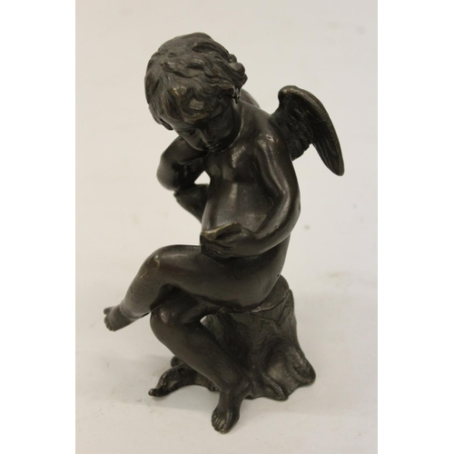 2133 - Late 19th / early 20th Century bronze patinated figure of a seated winged cherub reading a note, 5.5...
