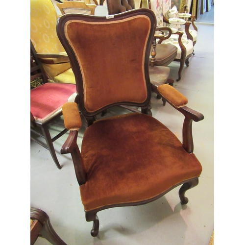 2136 - 19th Century rosewood open armchair with shaped padded back, overstuffed seat and raised on moulded ...