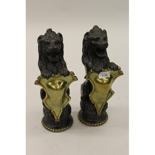 2140 - Pair of 19th Century French black patinated cast iron fireside figures of heraldic lions with brass ...