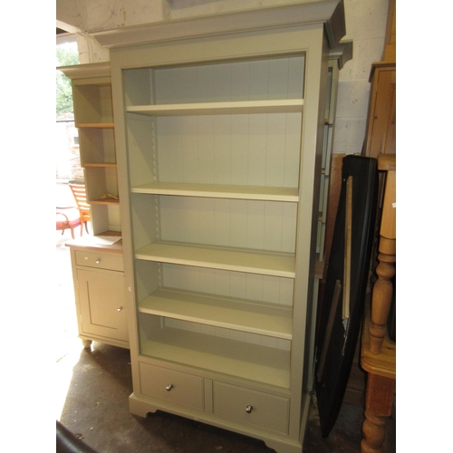 2142 - Good quality green painted full height open bookcase with 5 shelves above two drawers on bracket fee...