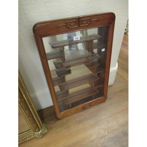 2146 - Mid 20th Century oriental hardwood wall cabinet with a single glazed door enclosing various shelves ...