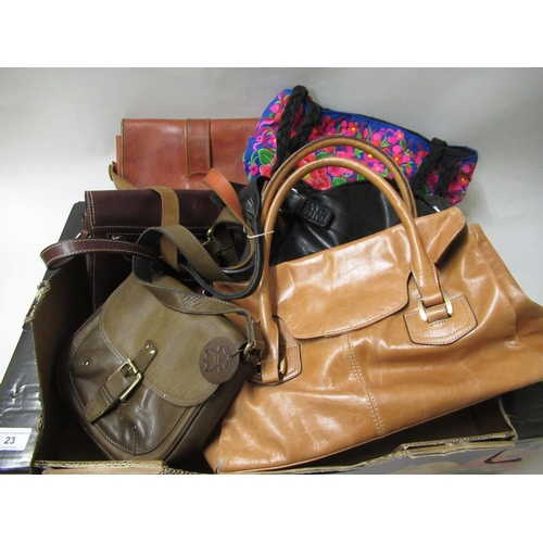23 - Box containing a collection of various ladies handbags including leather...