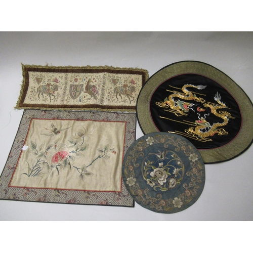 28 - Chinese circular silk work picture of a bird in foliage in an ebonised frame, 16ins diameter, togeth...