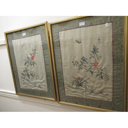 31 - Pair of 20th Century Chinese silk pictures of insects and flowers within patterned borders, gilt fra...