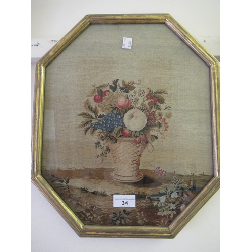 34 - 19th Century needlepoint picture, still life of fruits in a vase, 14.5ins x 12.25ins, octagonal gilt...