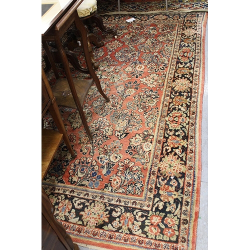 4 - Saruq rug with a typical all-over floral design on a rose ground with borders, 8ft 6ins x 5ft 4ins a...